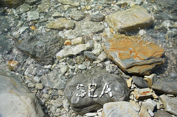 Letters Sea on stone of seashore
