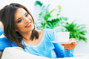 Woman drinking coffee at home.