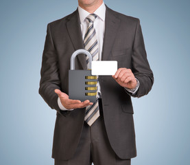 Businessman hold empty card and combination lock