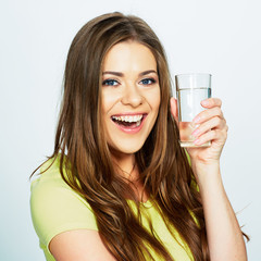 emotional portrait of young woman holding water glass