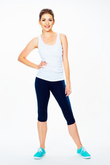 fitness woman in sport style standing against white background