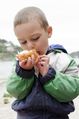 Child eating outdoors