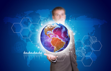 Businessman in suit hold Earth with hexagons and world map