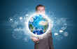 Businessman hold Earth with graphs, hexagons and network
