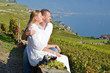 A couple looking to Geneva lake. Lavaux, Switzerland