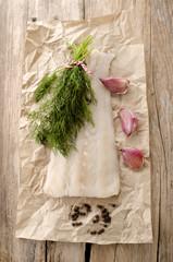 fresh cod fillet on kitchen paper
