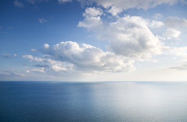 Blue sky with clouds over sea