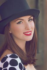 Woman wearing top hat