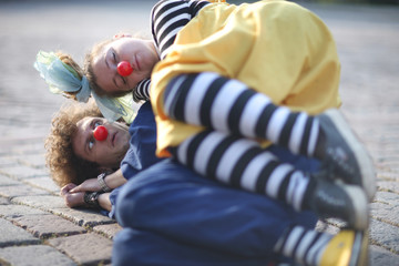 Sweet clown couple; street theater, pantomime