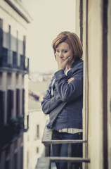 young woman suffering depression and stress outdoors at balcony
