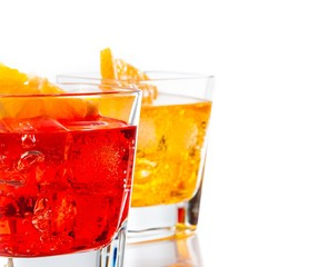 red and yellow cocktail with orange slice isolated
