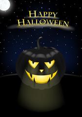 Halloween - leuchtender Kürbis bei Nacht