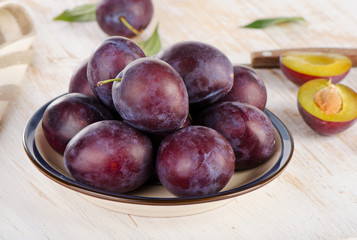 Fresh Plums on a  wooden background