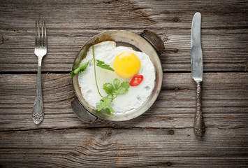 Fried egg on wooden background