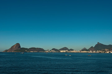 Rio de Janeiro City Skyline with its Hills in the Blue Sky