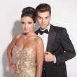 elegant couple posing together on studio background