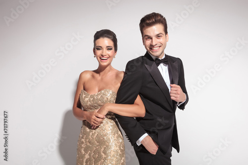Elegant couple laughing for the camera - 70797677