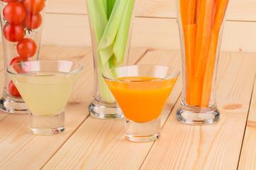Fresh vegetables juices in glasses.