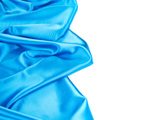 Blue silk background with some soft fold.