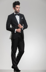 elegant man in tuxedo looking away from the camera