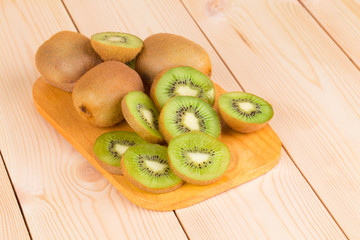 Kiwi fruits cut and whole.