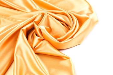 Orange silk background with some soft folds.