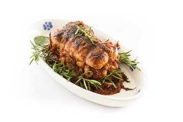 roast of veal with rosemary in white background