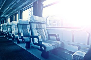 Passenger train interior with empty eats
