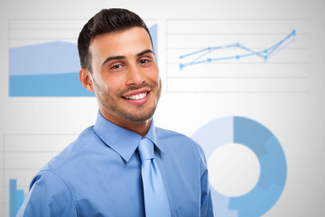 Businessman in front of business charts and diagrams