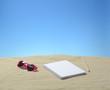 Arena con cuaderno y otros objetos