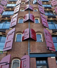 Amsterdam - Mortar apartment building with open shutters