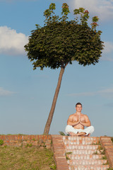 Man practicing yoga outdoors