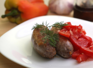 Sausages and tomato salad