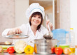 cook woman   cooks  with ladle in kitchen