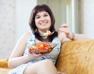 positive  woman eats  tomatoes  salad