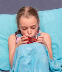 Sick child take medicine.