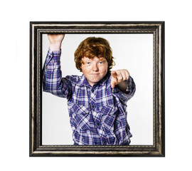 Red-haired boy posing with picture frame
