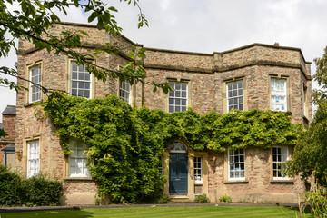 vine on old stone building, Wells
