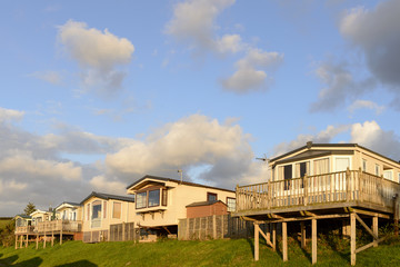 sunset on mobile houses  in st Audries bay, Somerset