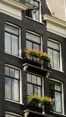 Flower baskets over canal in Amsterdam