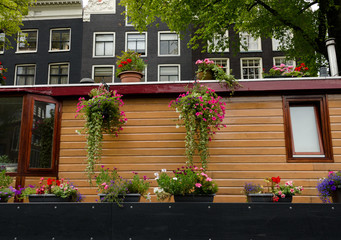 Flower baskets on a boat house in Amsterdam
