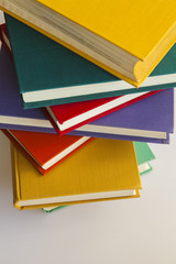 Rough pile of vintage books in multi-colored covers