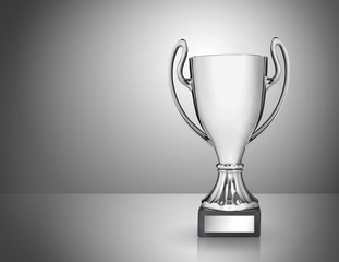 champion golden trophy on grey background