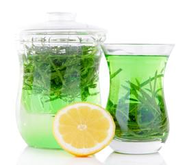 Estragon drink with lemon isolated on white