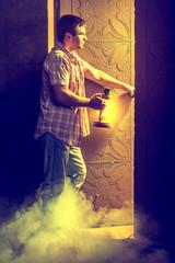 man before doorway of light