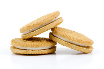 Vanilla cookies with cream filling on white background