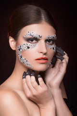 Beautiful sensual woman with face-art makeup