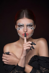 Beautiful sensual  woman showing silence gesture