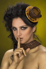 Beautiful woman in coffee style and showing silence gesture