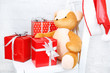 Christmas presents on white chair on brick wall background